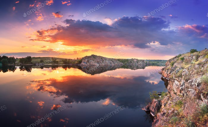 Beautiful summer sunset at the river with colorful sky
