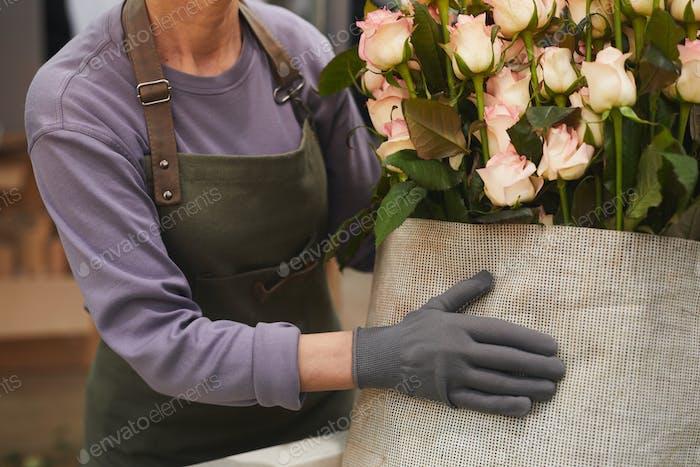 Woman warming roses