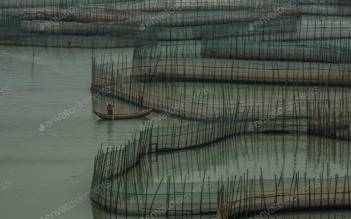 prawn farmer in his boat