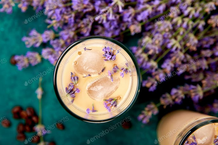 Summer drink iced coffee with lavender in glass