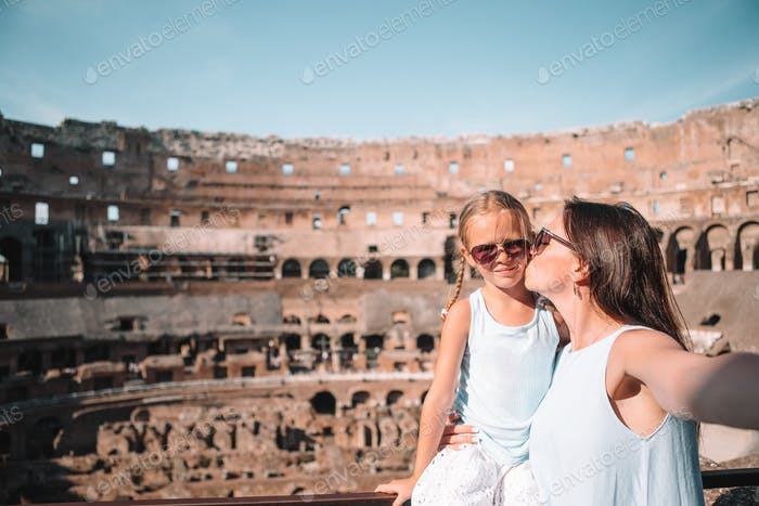 Mother and little happy girl at famous place in Europe