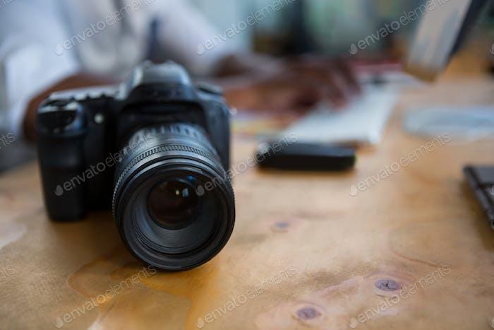 Digital camera on office desk