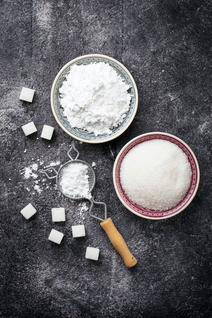Sugar and powder on concrete background