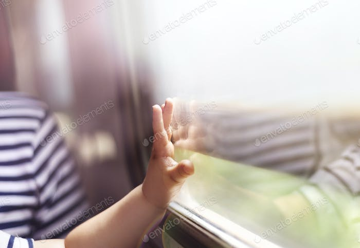 Detail of children hand in train