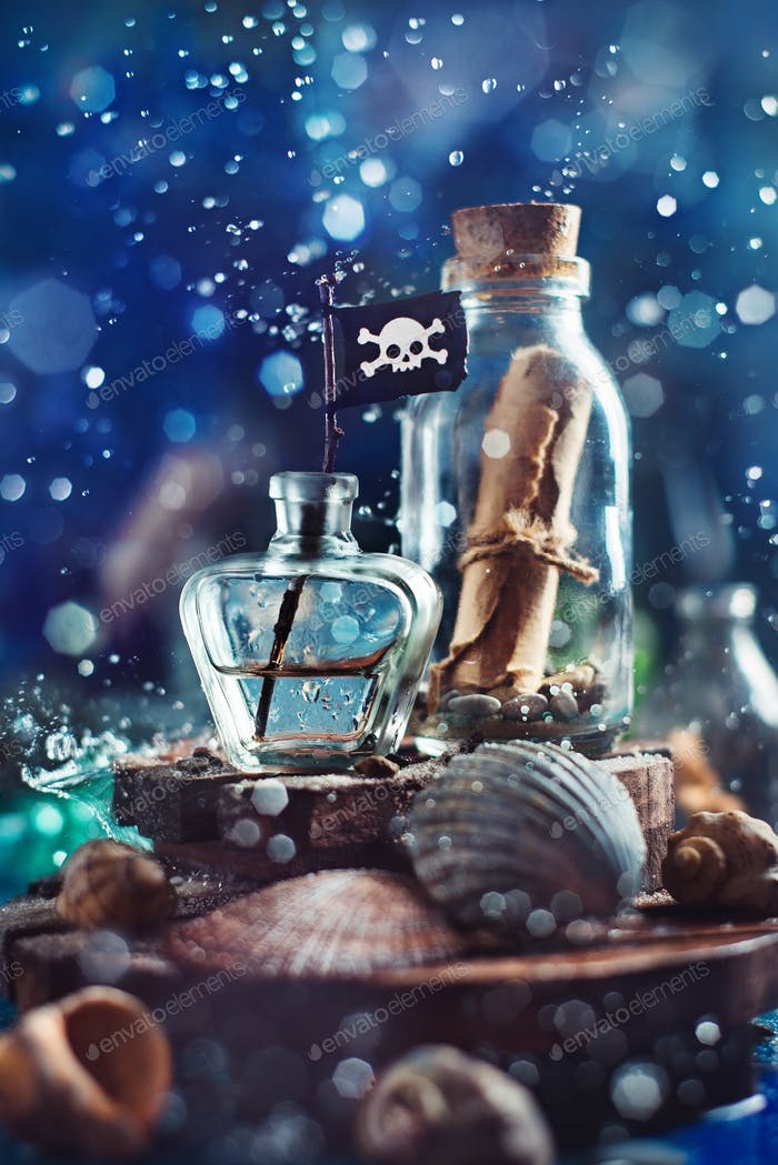 Bottle with a message, seashells and pirate flag