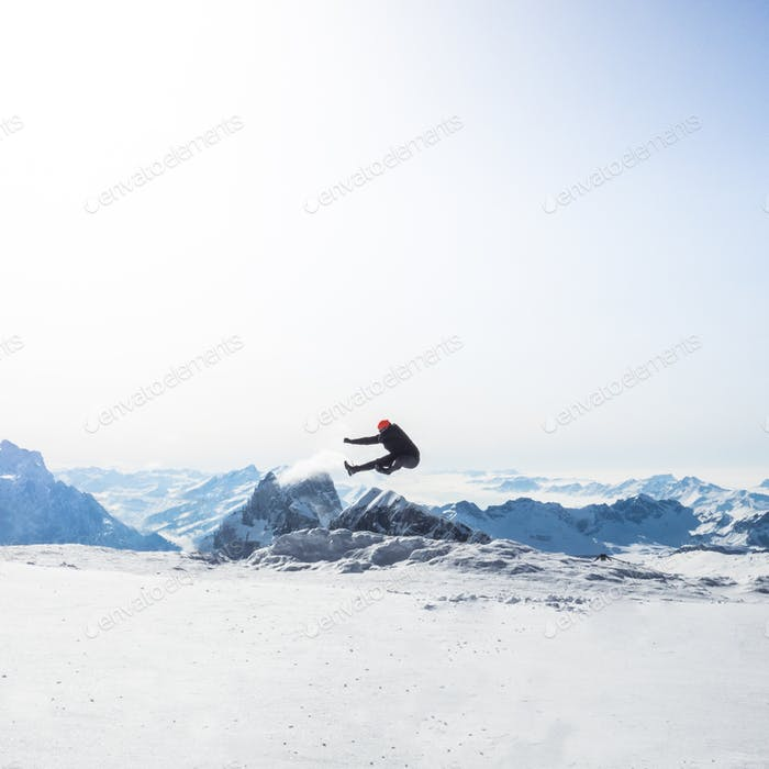 Man jumping above the mountains.
