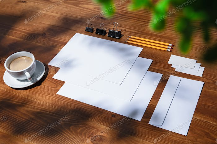Creative and cozy workplace at home office, inspirational mock up with plant shadows on table