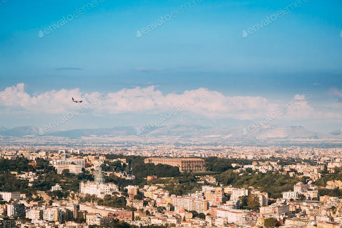 Naples, Italy. Plane Flying Above City. Top View Of Cityscape