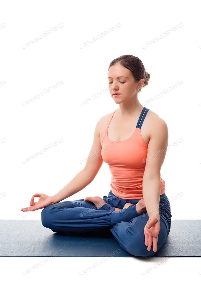 Fit yogini woman meditating in yoga asana Padmasana Lotus pose