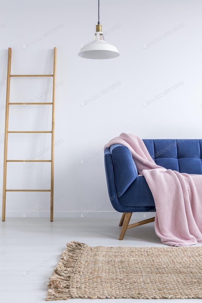 Trendy interior with blue sofa