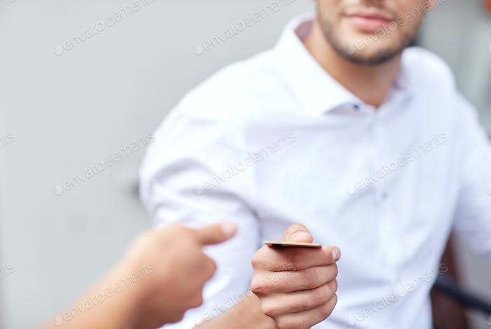 close up of man giving credit card to waiter
