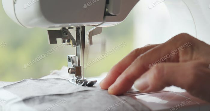 Sewing machine stitching on fabric