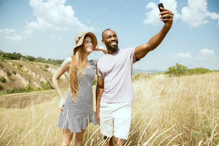 Young multiethnic international couple outdoors