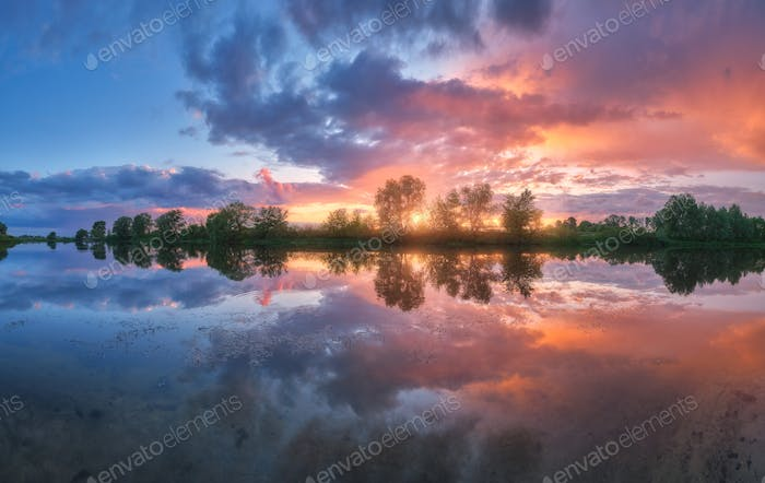 Beautiful river coast at sunset in summer. Colorful landscape