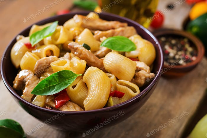 Pasta Gomiti Rigati with meat and vegetables in an Asian style.
