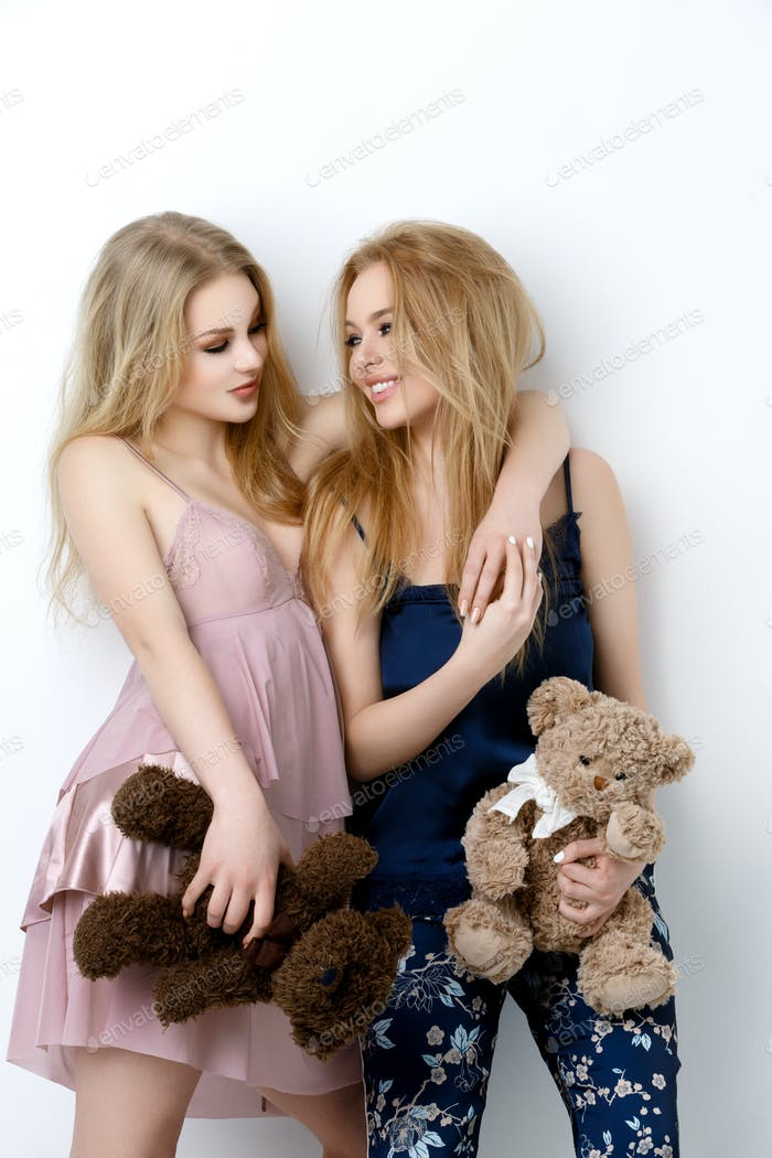 Two beautiful girls lying on pilloows