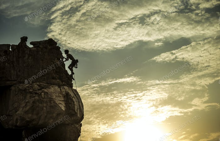 Mountaineer climbing a rock formation.