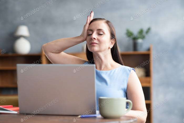 Woman training neck muscles resting taking a break from work.