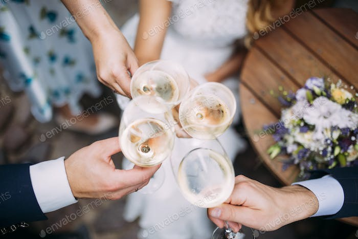 Four people toast at the wedding