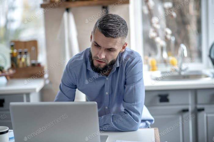 Bearded man working remotely at the weekend