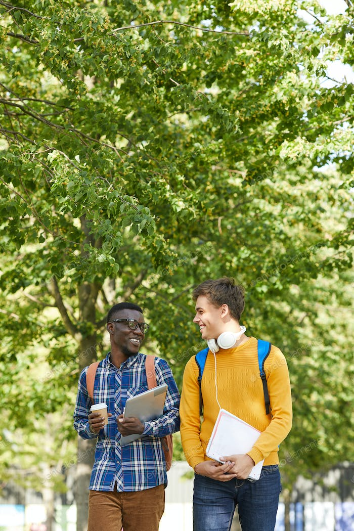 Two College Students Walking in Campus