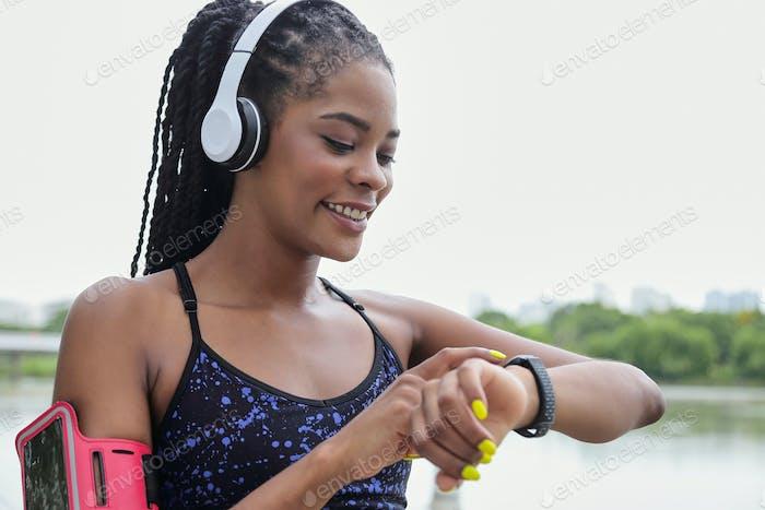 Sportswoman checking fitness tracker