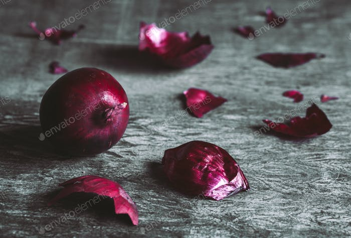 red onions on dark background