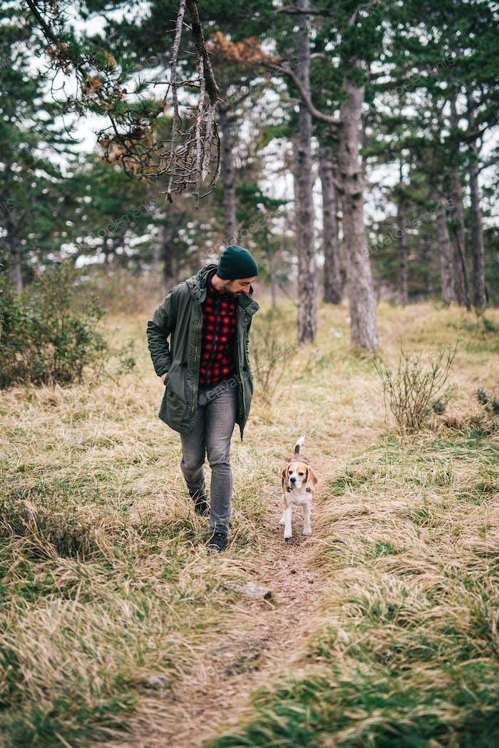 Man and his dog running