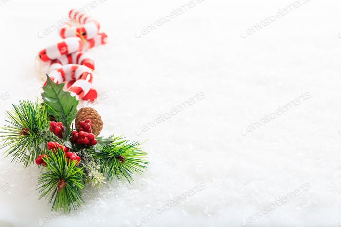 Candy canes and christmas decoration on snow
