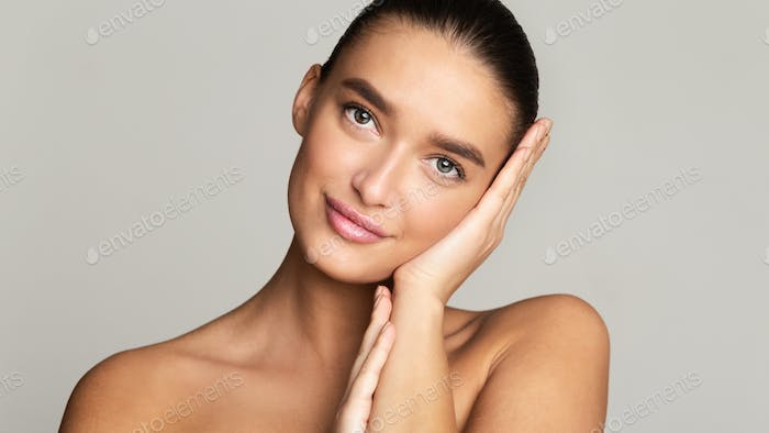 Woman with perfect skin looking at camera