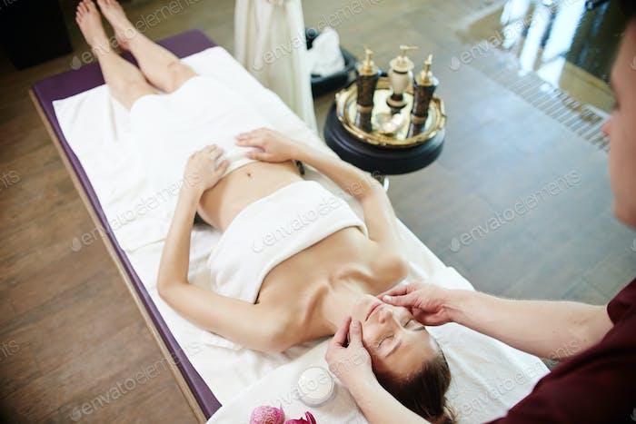 Woman Enjoying Relaxing Massage in SPA