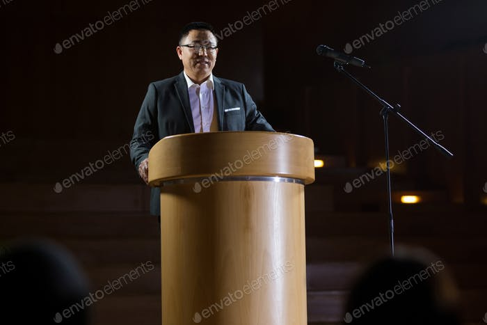 Business executive giving a speech