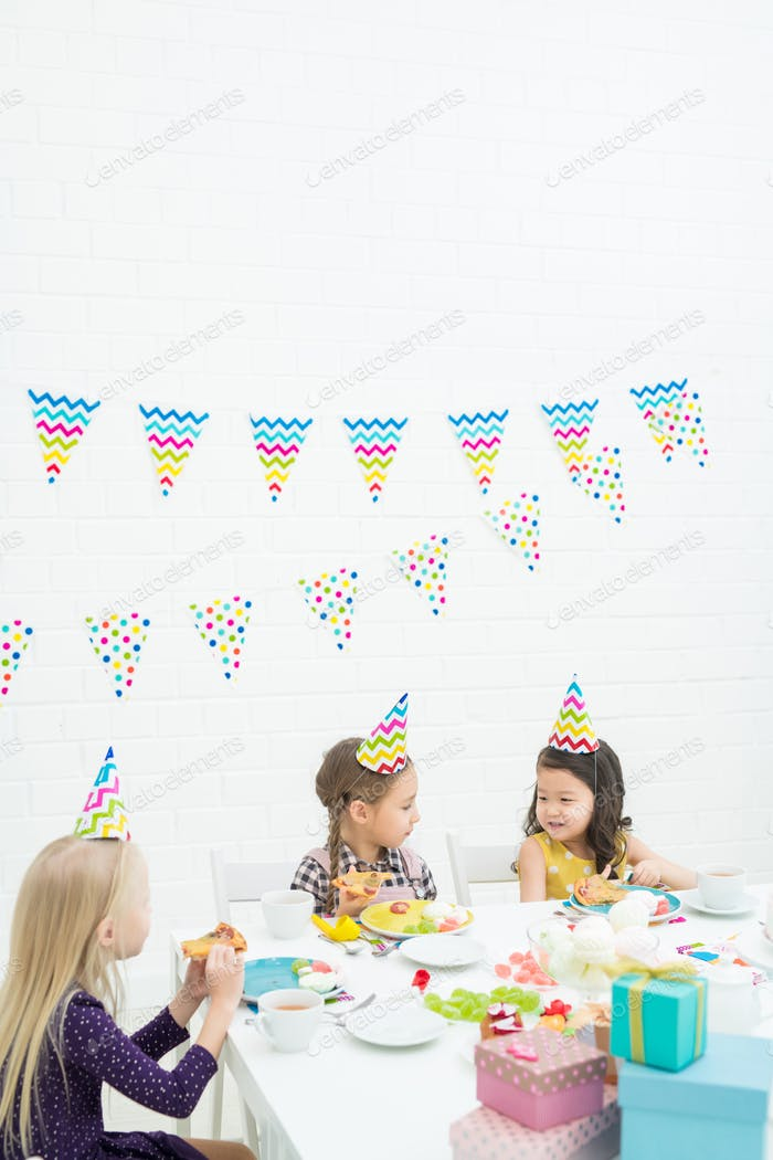 Multi-ethnic kids enjoying birthday party