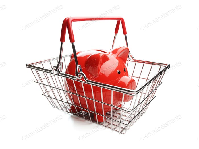 Piggy bank in shopping basket on white background