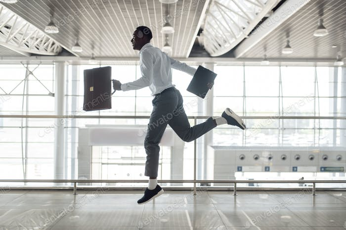 Ebony businessman flies on the wings of happiness