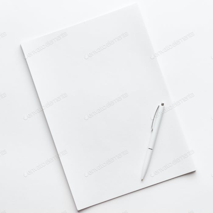 Blank Sheet Of Paper And Pen