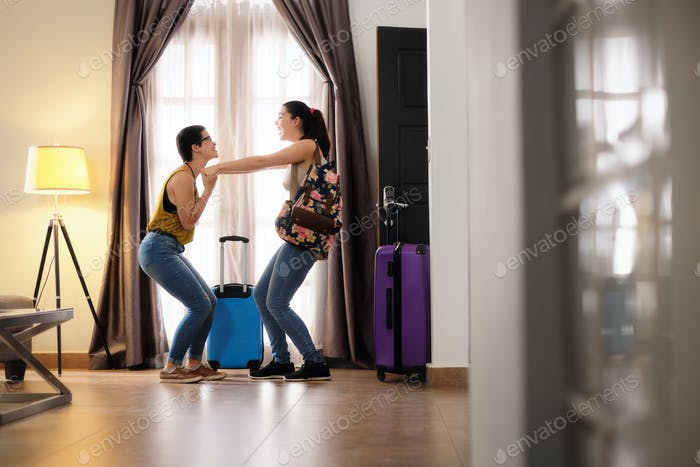 Happy Lesbian Women In Hotel Room On Holidays Couple Travel