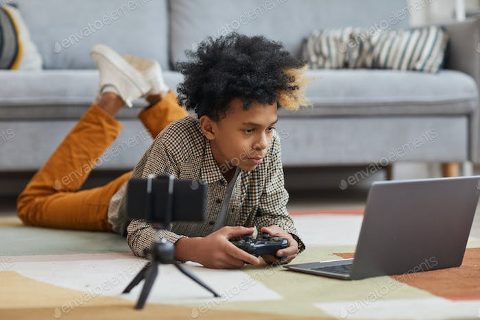 African-American Boy Playing Videogames on Floor