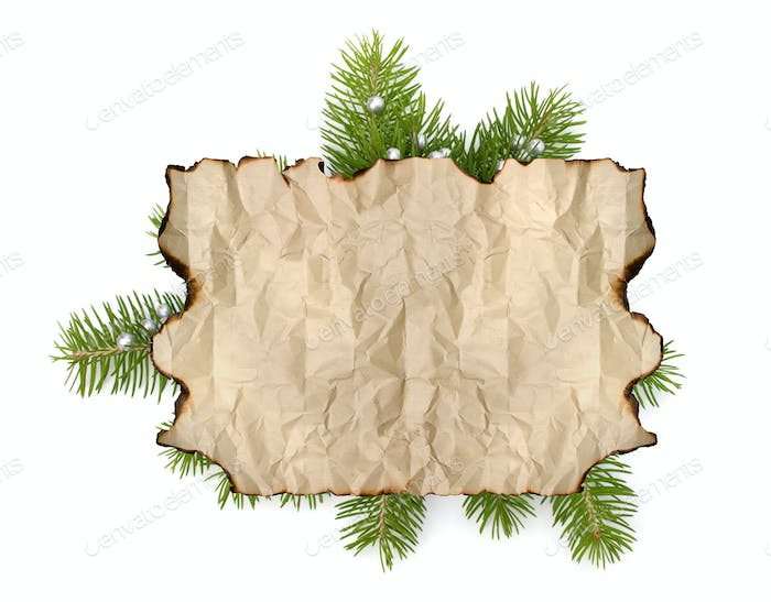 Old parchment paper with copy space on Christmas tree branch background