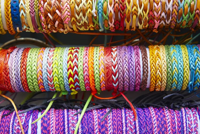 Colorful wristbands. Fabric textured background. Hand made. Horizontal