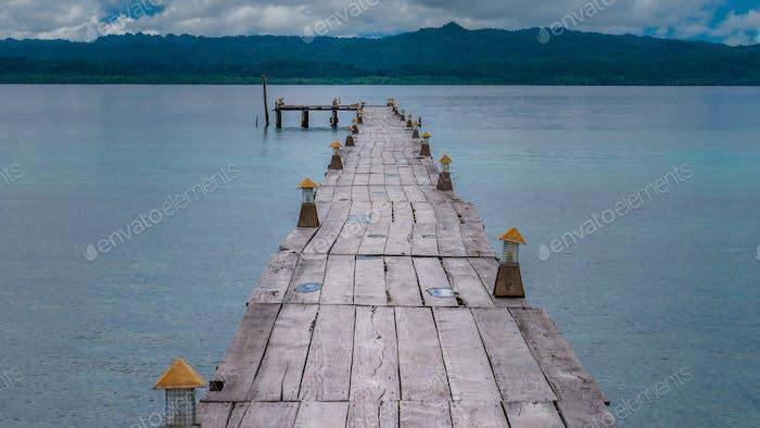 Pier of Dive Station - Kri Island. Clound above Gam in Background. Raja Ampat, Indonesia, West Papua