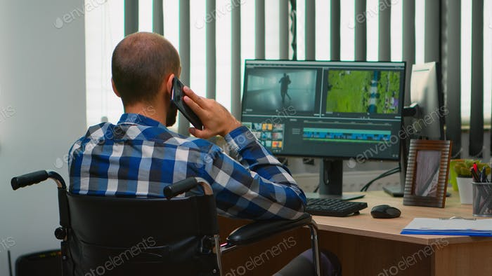 Disabled freelancer videographer talking on phone