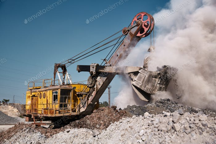 Quarry bucket excavator works in a slag dump