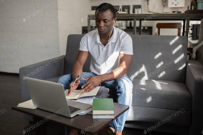 African American student having online conversation with teacher