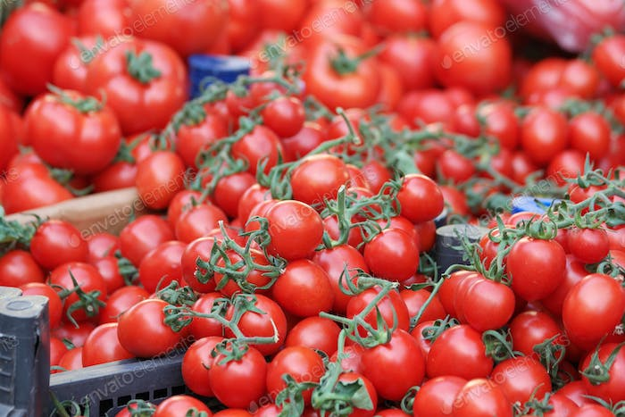Small red ripe tomatoes background.