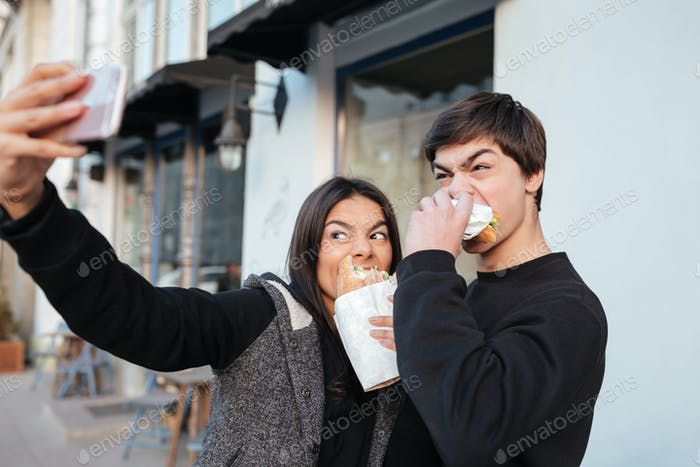 Brother and woman making selfie