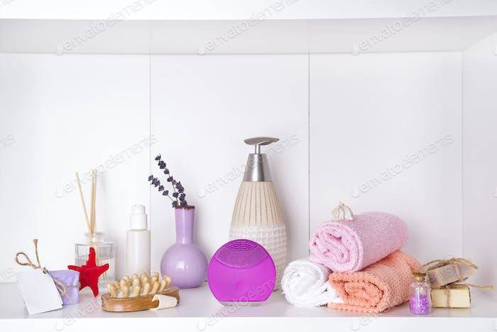 Composition with spa cosmetic, candles and brush for face, isolated on white