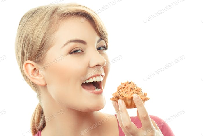 Vintage photo, Happy woman eating fresh cupcake, delicious dessert