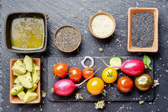 Top view at fresh organic vegetables on slate stone tray with sp