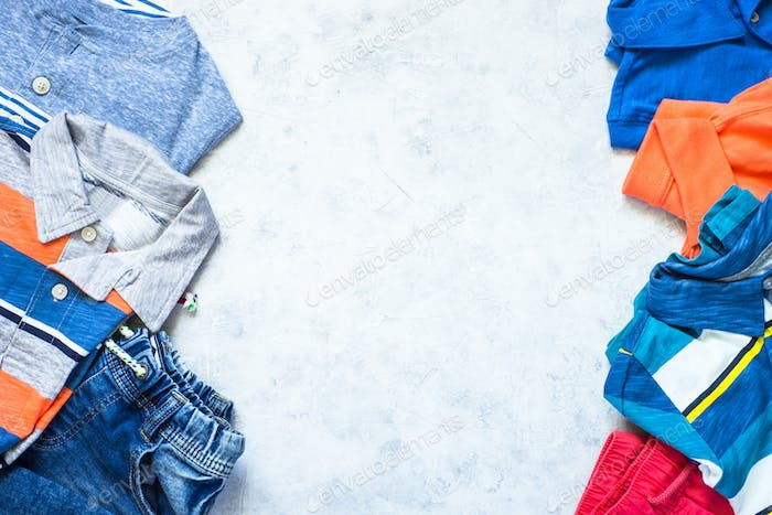 Child clothes - jeans, polo and sneakers top view